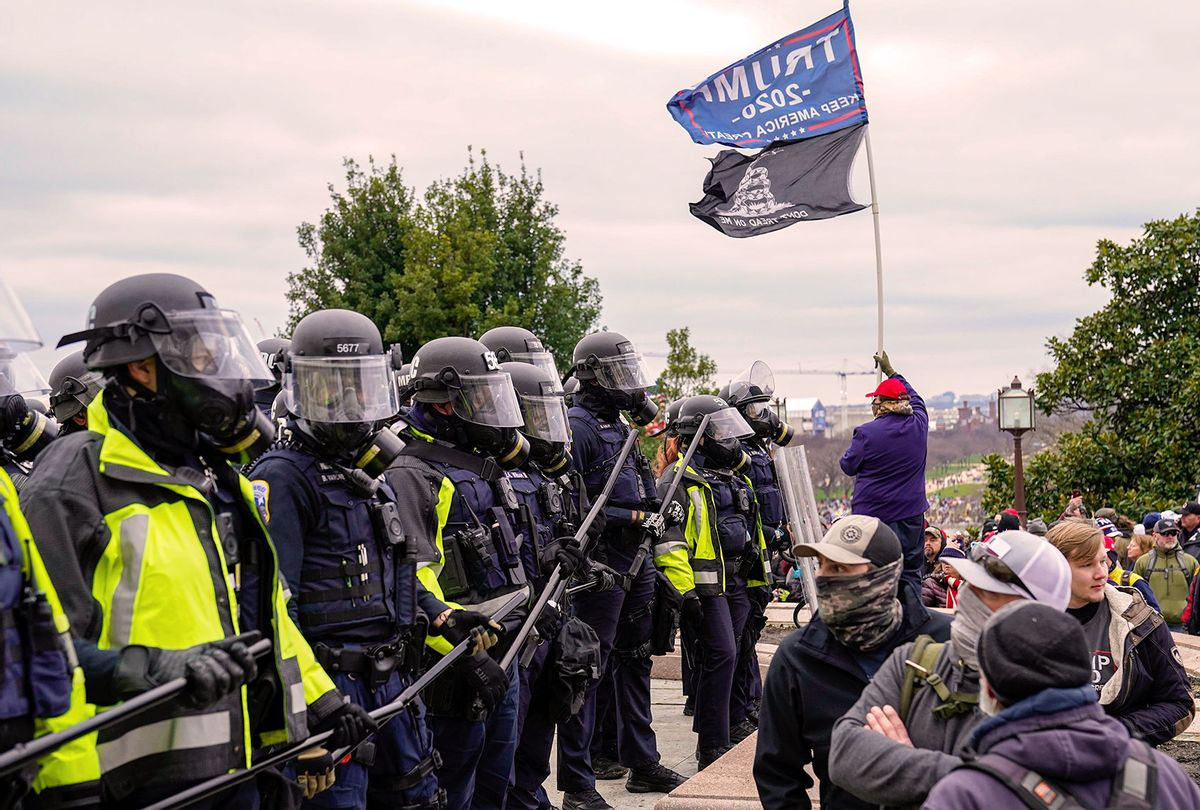 """Capitol Hill police hold back protesters as crowds gather outside the U.S. Capitol for the """"Stop the Steal"""" rally on January 06, 2021 in Washington, DC. Trump supporters gathered in the nation's capital today to protest the ratification of President-elect Joe Biden's Electoral College victory over President Trump in the 2020 election. (Robert Nickelsberg/Getty Images)"""