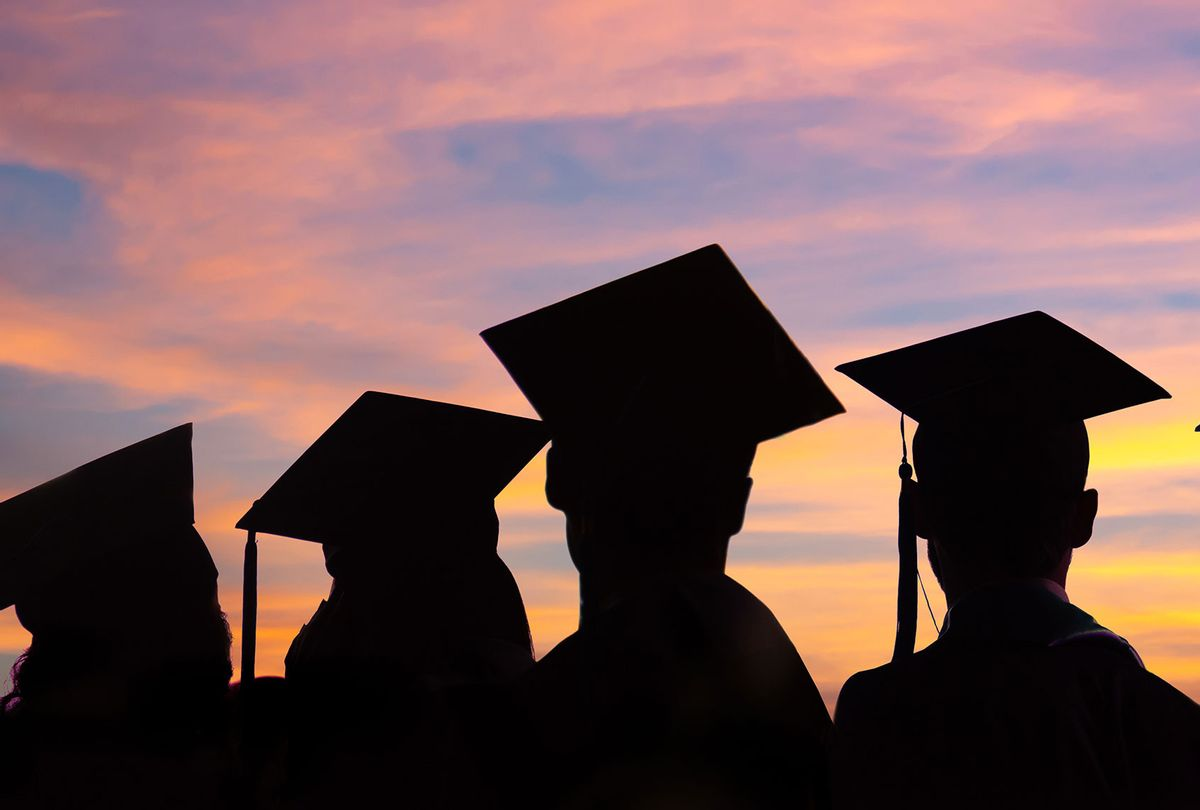 Silhouettes of students with graduate caps in a row on sunset background (Getty Images)