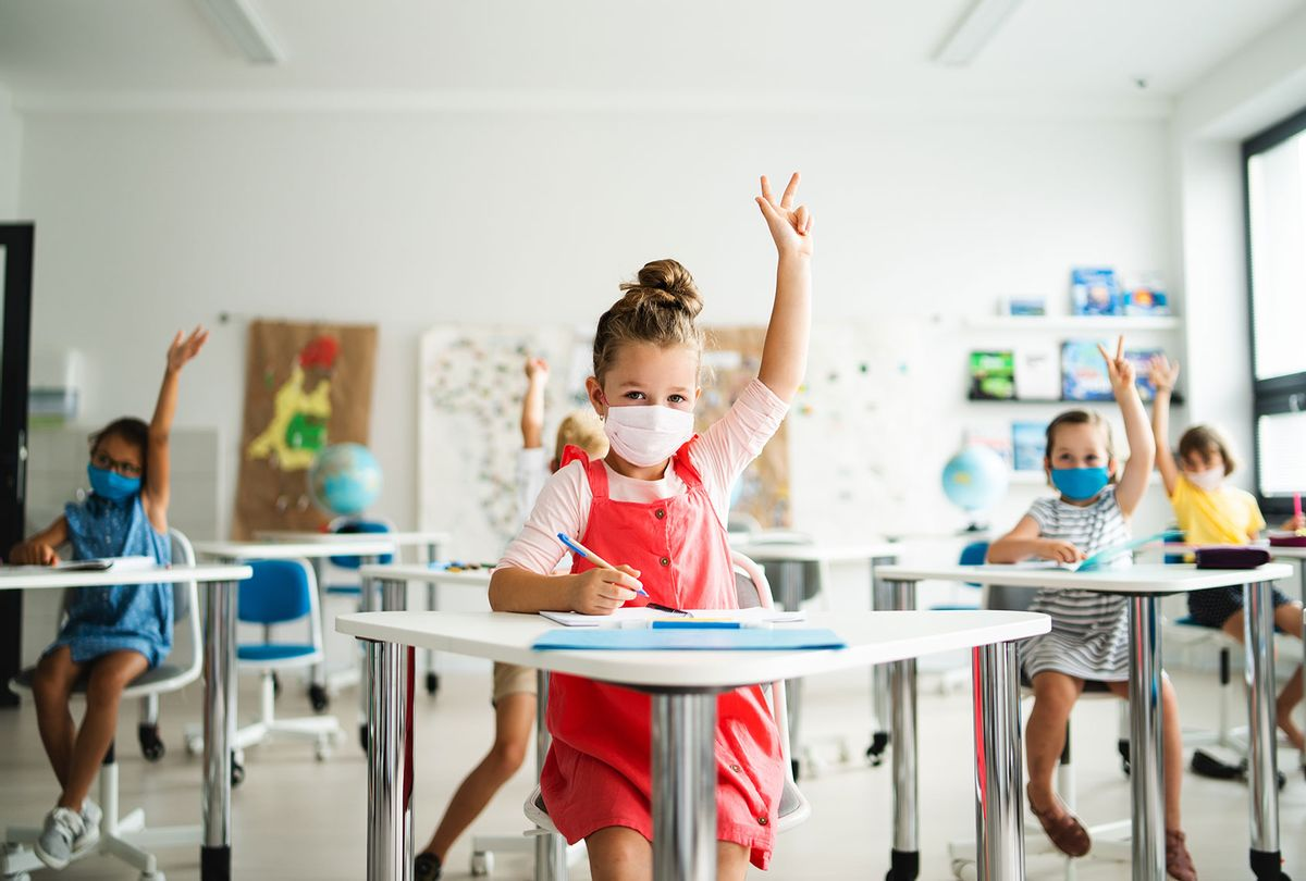 Small children with face mask back to school (Getty Images)