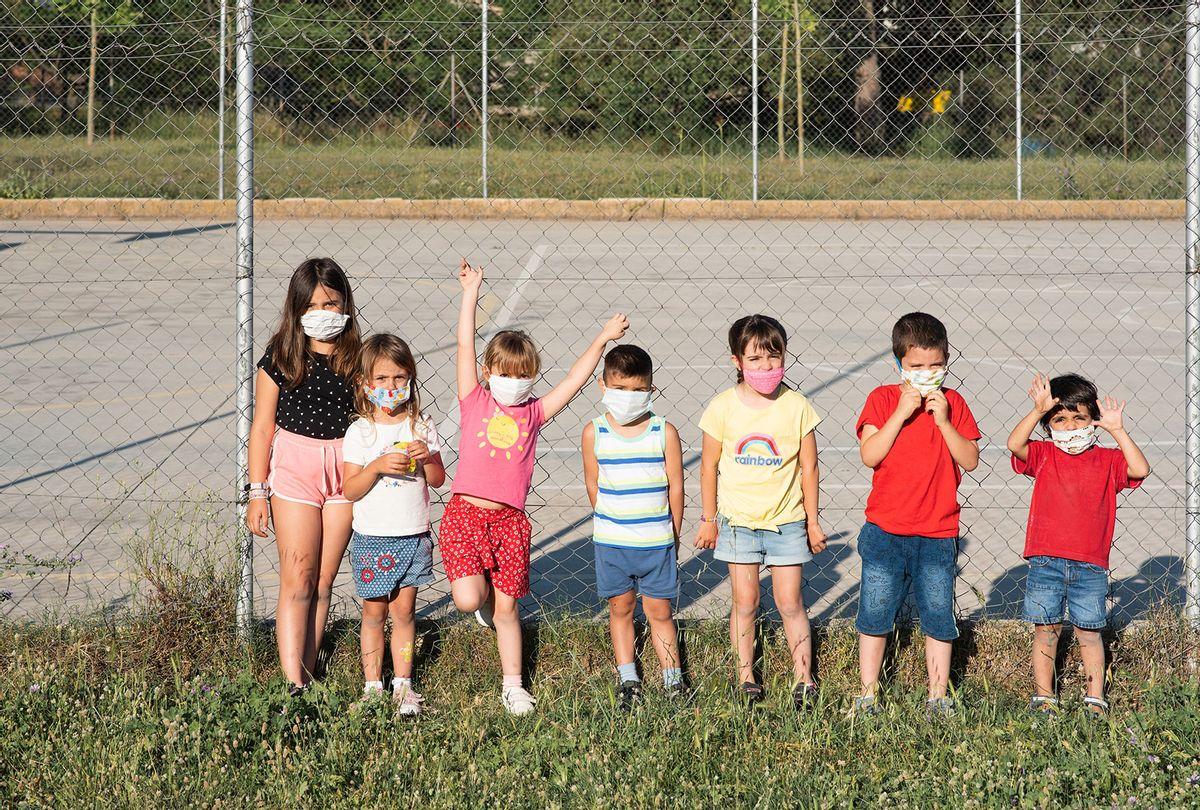 Children playing in the park in face masks (Getty Images)