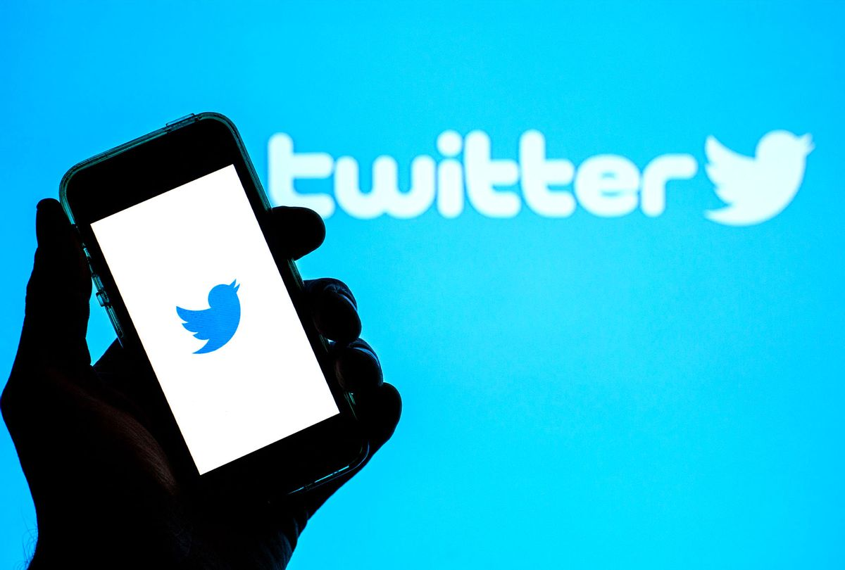 Twitter app seen displayed on a smartphone with the Twitter logo in the background (Illustration by Thiago Prudêncio/SOPA Images/LightRocket via Getty Images)