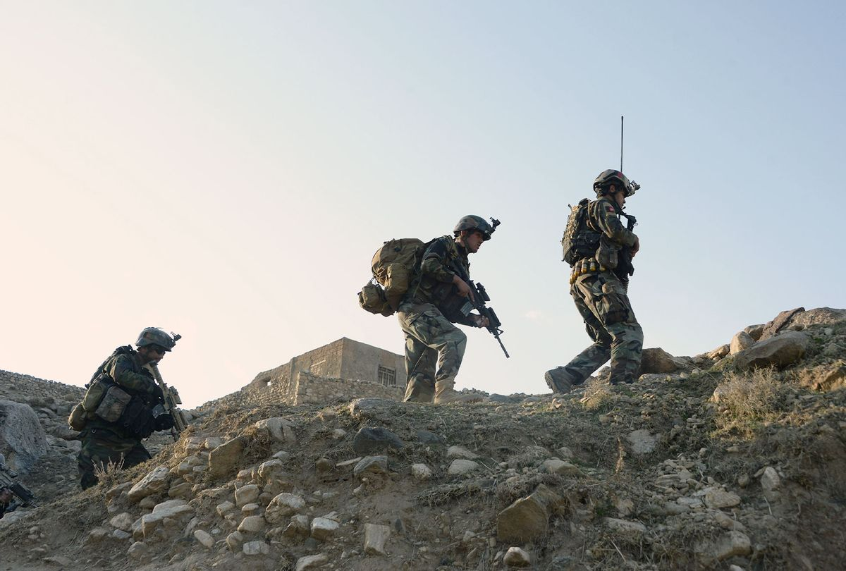 In this photograph taken on January 3, 2018, Afghan commandos forces patrol during ongoing US-Afghan military operation against Islamic State militants in Achin district of Nangarhar province. Afghan security forces are conducting most of the fighting against the Taliban and other insurgent groups as US troops operate alongside them in a training capacity and are frequently on the front lines. (NOORULLAH SHIRZADA/AFP via Getty Images)
