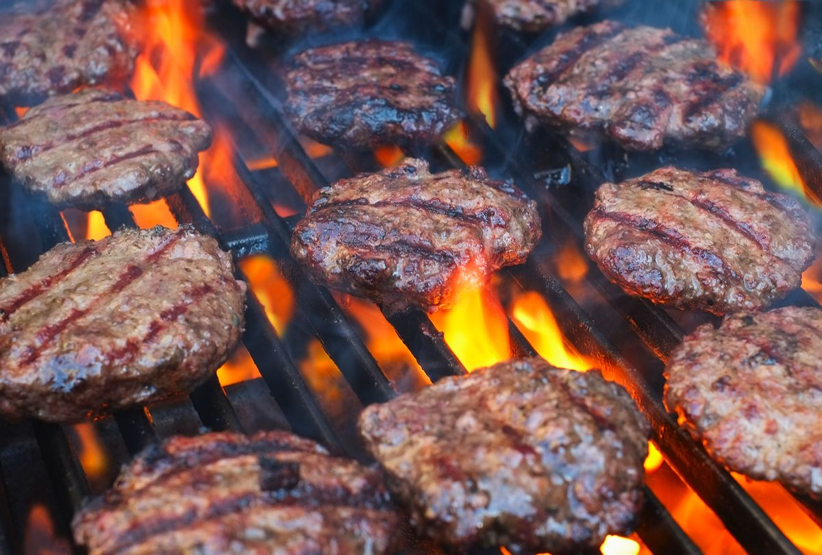 Burgers Cooking On A Grill (Getty Images)