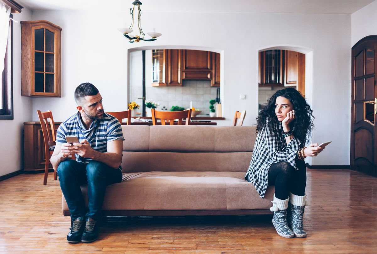 Couple with relationship difficulties sitting on sofa (Getty Images)