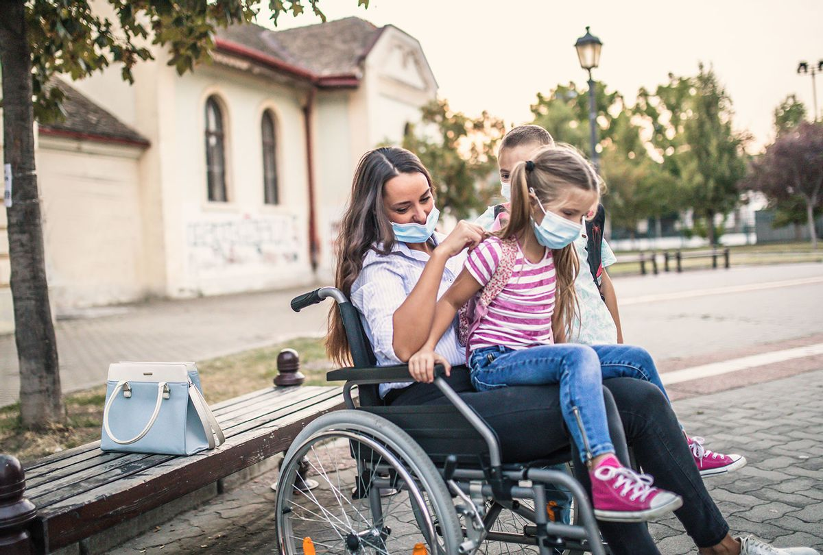 Handicapped mother with child (Getty Images)