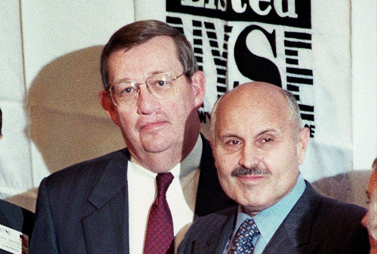 Exxon Corporation Chairman and Chief Executive Officer Lee Raymond (C) and Vice Chairman Lucio Noto, circa 01 December, 1999. (HENNY RAY ABRAMS/AFP via Getty Images)