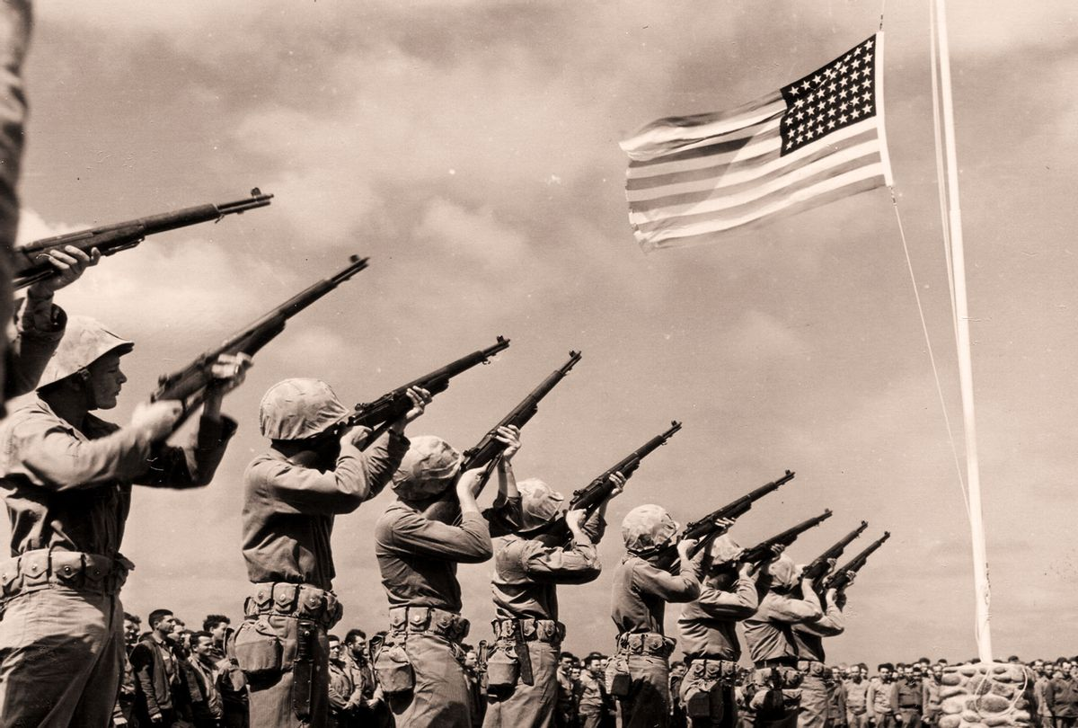 US Firing Squad salute the dedication of Fifth Marine Division Cemetery (PhotoQuest/Getty Images)