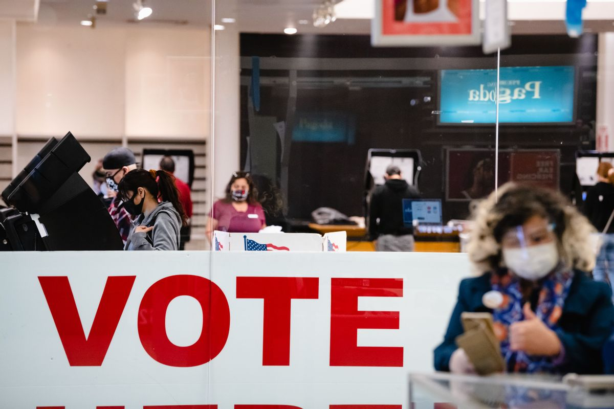 A woman casts her ballot inside the Basset Place Mall in El Paso, Texas on November 3, 2020. (Justin HAMEL / AFP)