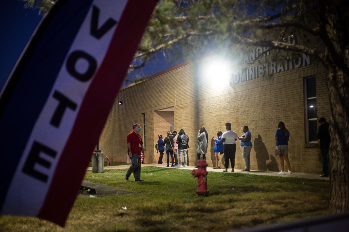 Voters wait in line to cast their ballot on Nov. 3, 2020, at the Manor ISD Administration building in Manor, Texas (Getty Images)