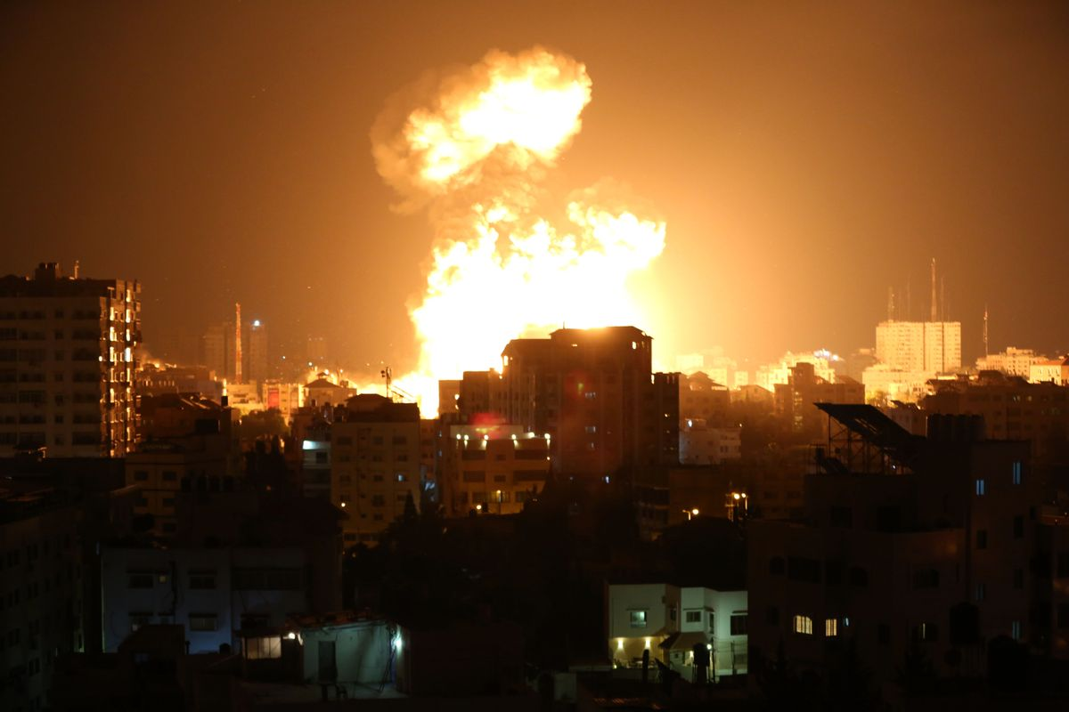 Smoke and flames rise after Israeli fighter jets conducted airstrikes in Gaza City, Gaza on May 13, 2021. (Ashraf Amra/Anadolu Agency via Getty Images)