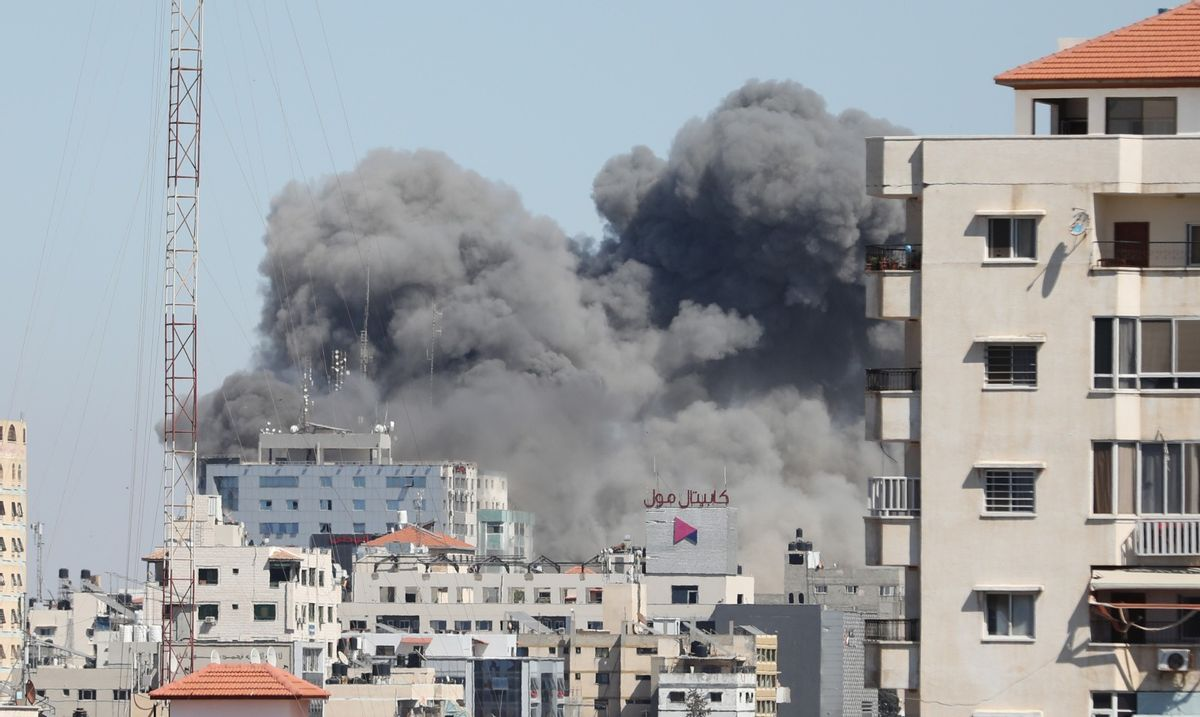 Smoke rises after Israeli forces destroyed a building in Gaza City where Al-Jazeera and The Associated Press had their offices. (Mustafa Hassona/Anadolu Agency via Getty Images)