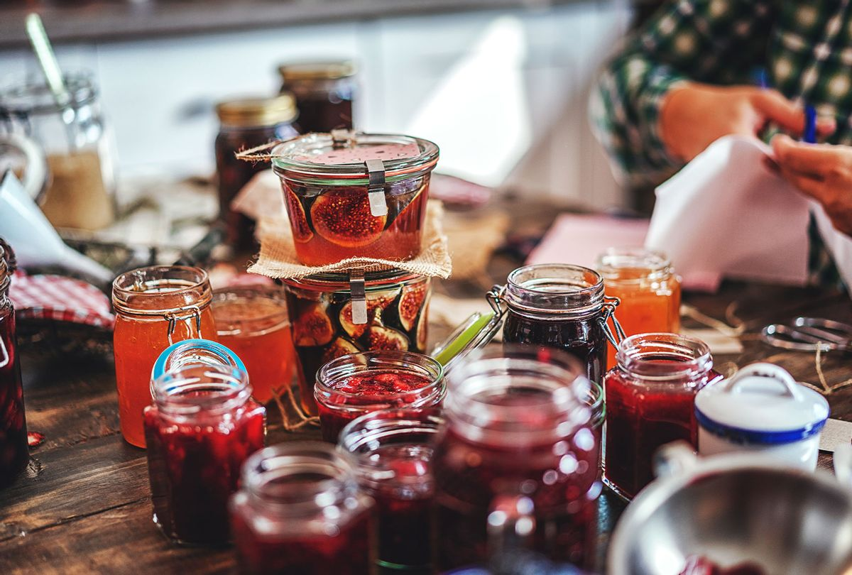 Preparing Homemade Strawberry, Blueberry and Raspberry Jam and Canning in Jars (Getty Images)