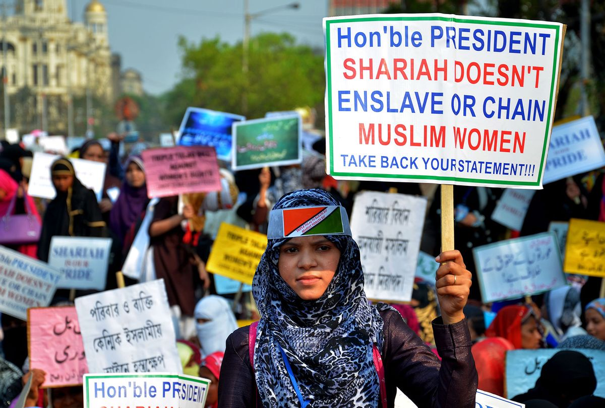 """Indian Muslim women hold placards and take part in a silent protest rally to demand a repeal of the """"triple talaq"""" or instant divorce bill  (Sanjay Purkait/Pacific Press/LightRocket via Getty Images)"""