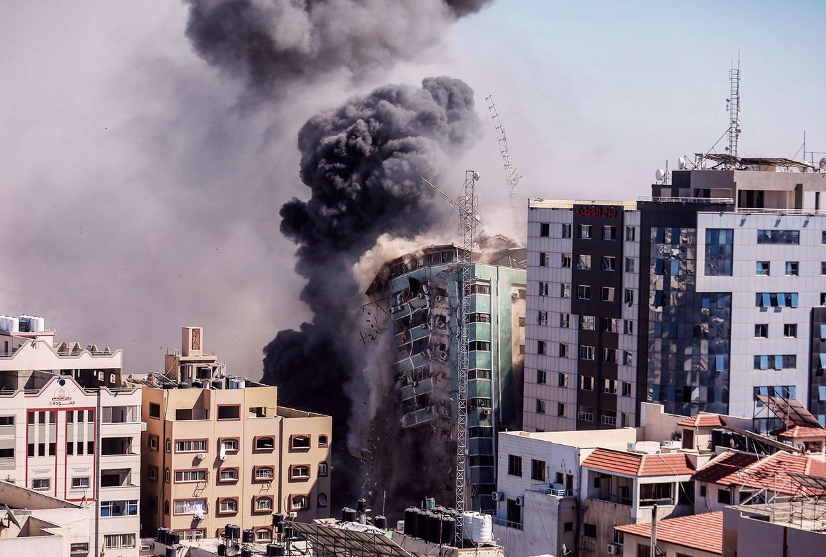 Smoke rise after an Israeli air-strike hits at Al-Jalaa tower, which houses apartments and several media outlets, including The Associated Press and Al Jazeera, amid the escalating flare-up of Israeli-Palestinian violence. (Mohammed Talatene/picture alliance via Getty Images)