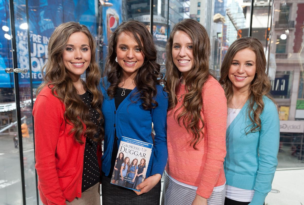 """Jessa Duggar, Jinger Duggar, Jill Duggar, and Jana Duggar visit """"Extra"""" at their New York studios at H&M in Times Square on March 11, 2014 in New York City. (D Dipasupil/Getty Images for Extra)"""