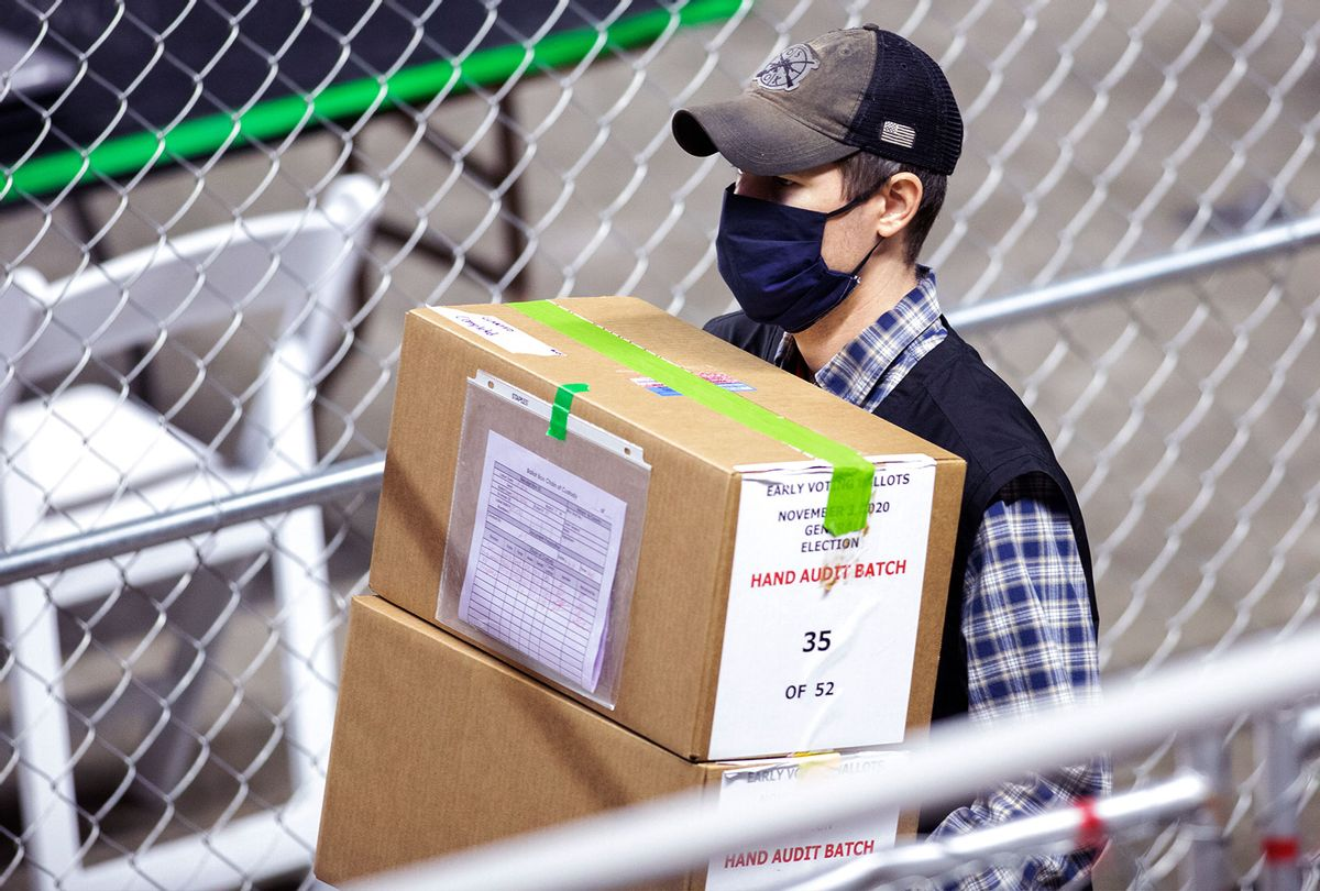 A contractor working for Cyber Ninjas, who was hired by the Arizona State Senate transports ballots from the 2020 general election at Veterans Memorial Coliseum on May 1, 2021 in Phoenix, Arizona. The Maricopa County ballot recount comes after two election audits found no evidence of widespread fraud in Arizona. (Courtney Pedroza/Getty Images)