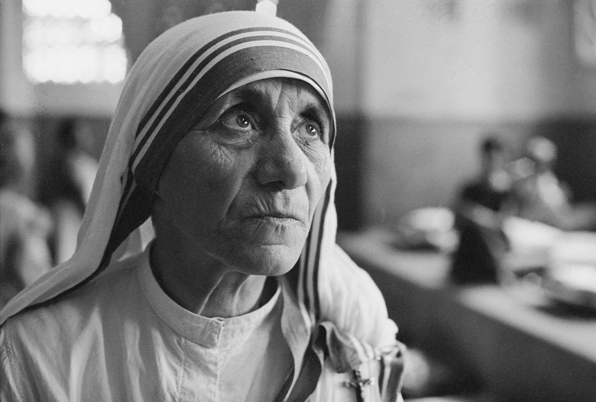 Albanian Roman Catholic nun and founder of the Missionaries of Charity, Mother Teresa (1910 - 1997) at a hospice for the destitute and dying in Kolkata (Calcutta), India, 1969. (Terry Fincher/Hulton Archive/Getty Images)