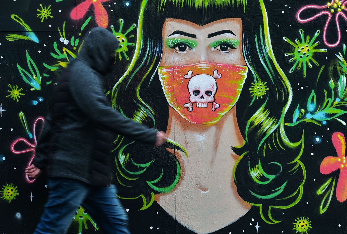 A man walks past a mural by Mr. Gabriel Marques in Dublin (Artur Widak/NurPhoto via Getty Images)