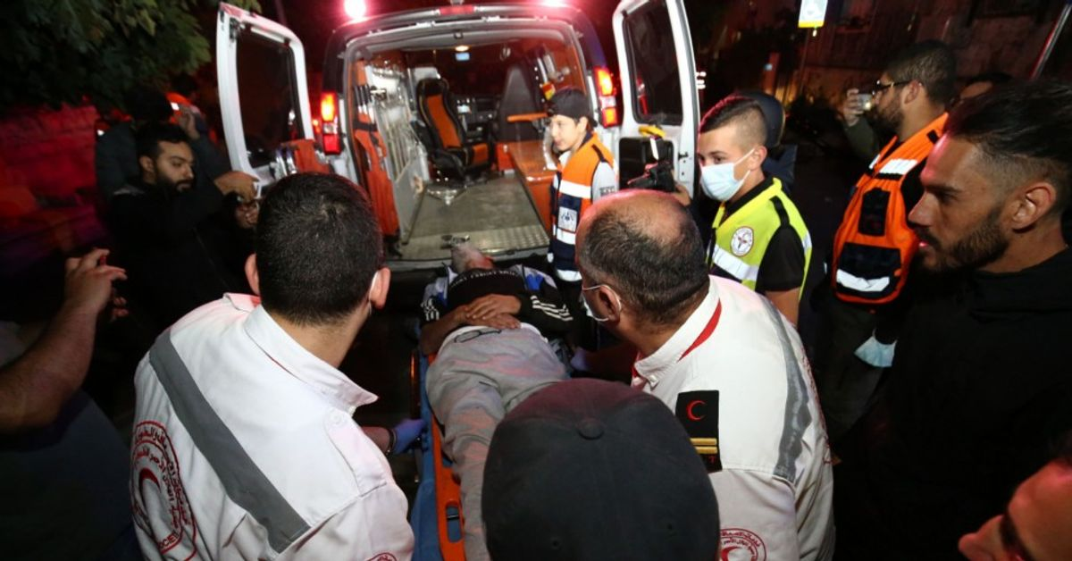 Injured Palestinian Salih Diyab is carried to an ambulance after Israeli forces cracked down on demonstrations against the forced eviction of Palestinian families from their homes in East Jerusalem's Sheikh Jarrah neighborhood on May 6, 2021. (Mostafa Alkharouf/Anadolu Agency via Getty Images)