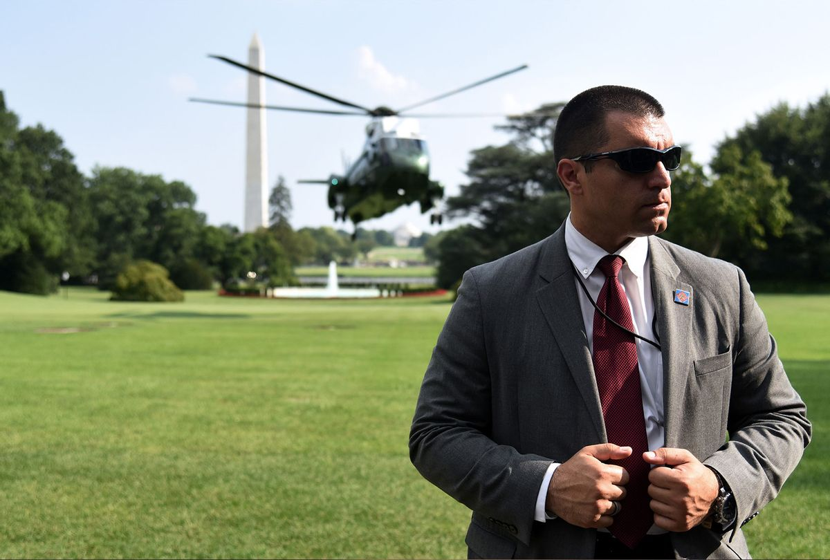 A Secret Service agent stands guard as Marine One with US President Donald Trump on board, lands at the White House on July 21, 2019, in Washington, DC. (OLIVIER DOULIERY/AFP via Getty Images)