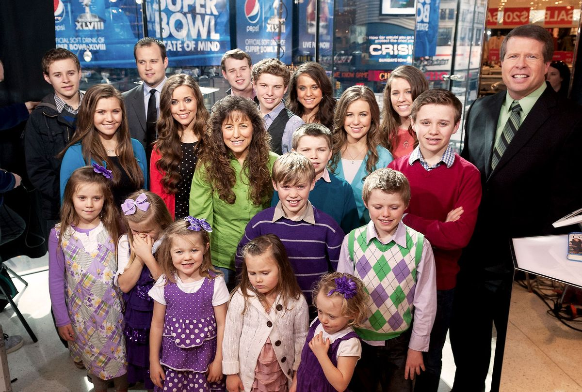 """The Duggar family visits """"Extra"""" at their New York studios at H&M in Times Square on March 11, 2014 in New York City. (D Dipasupil/Getty Images for Extra)"""