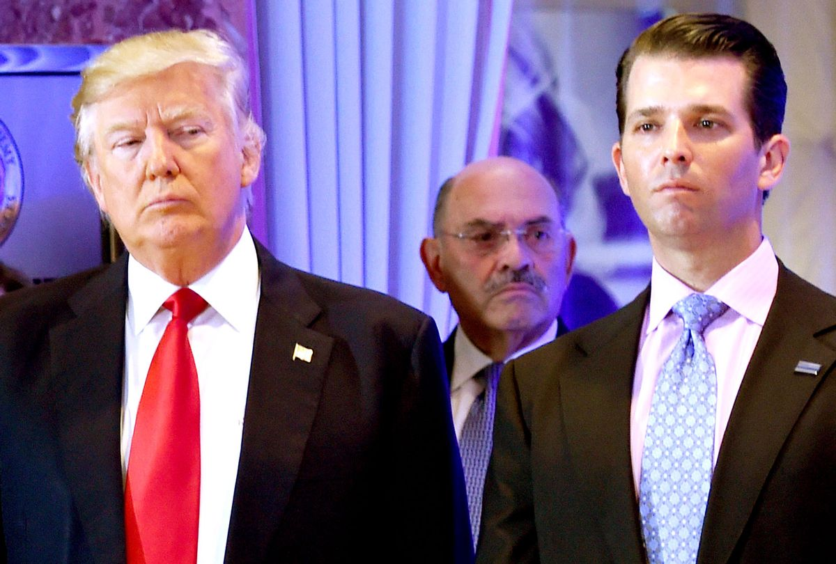 US President-elect Donald Trump along with his son Donald, Jr., arrive for a press conference at Trump Tower in New York, as Allen Weisselberg (C), chief financial officer of The Trump, looks on January 11, 2017. (TIMOTHY A. CLARY/AFP via Getty Images)
