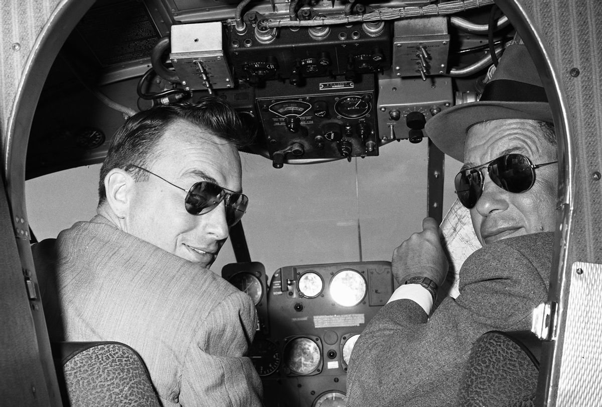 Two male pilots in the cockpit of airplane wearing sunglasses, Oklahoma, USA, 1955 (Constance Bannister Corp/Getty Images)