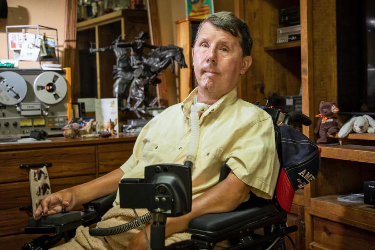 David Taylor, who has muscular dystrophy, relies on a ventilator to live. During the power outages across Texas in February, he had to be transported to a hospital before his ventilator's backup battery ran out. (Rodger Mallison / Undark)