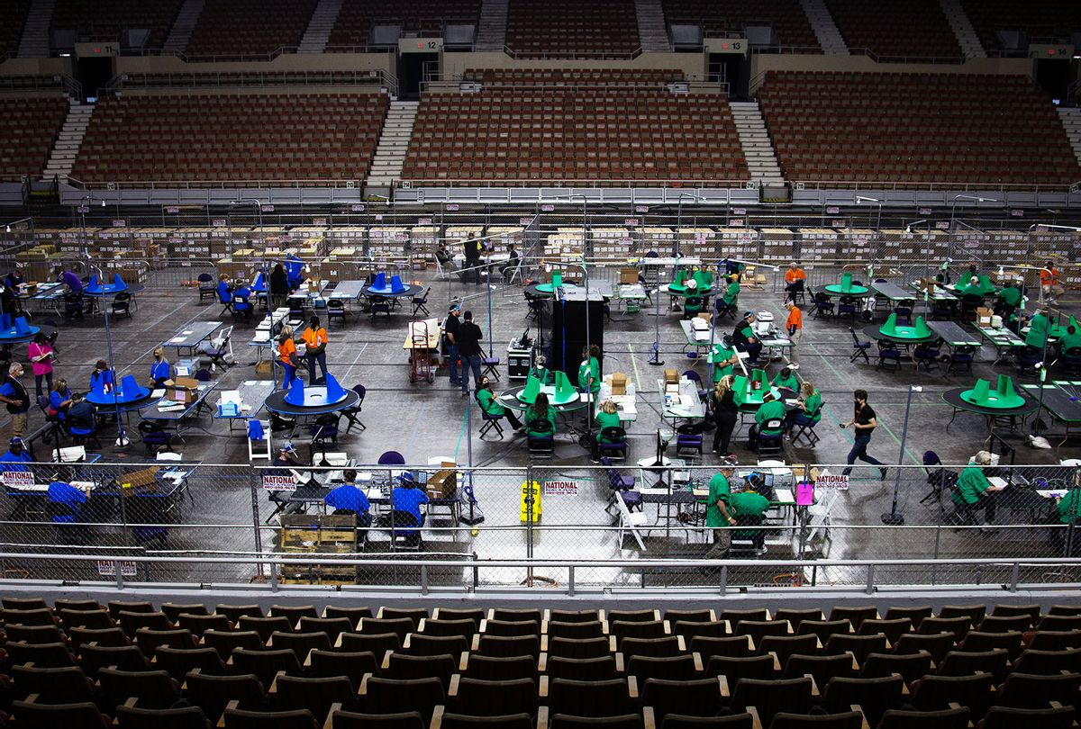 Contractors working for Cyber Ninjas, who was hired by the Arizona State Senate, examine and recount ballots from the 2020 general election at Veterans Memorial Coliseum on May 8, 2021 in Phoenix, Arizona. (Courtney Pedroza for the Washington Post)