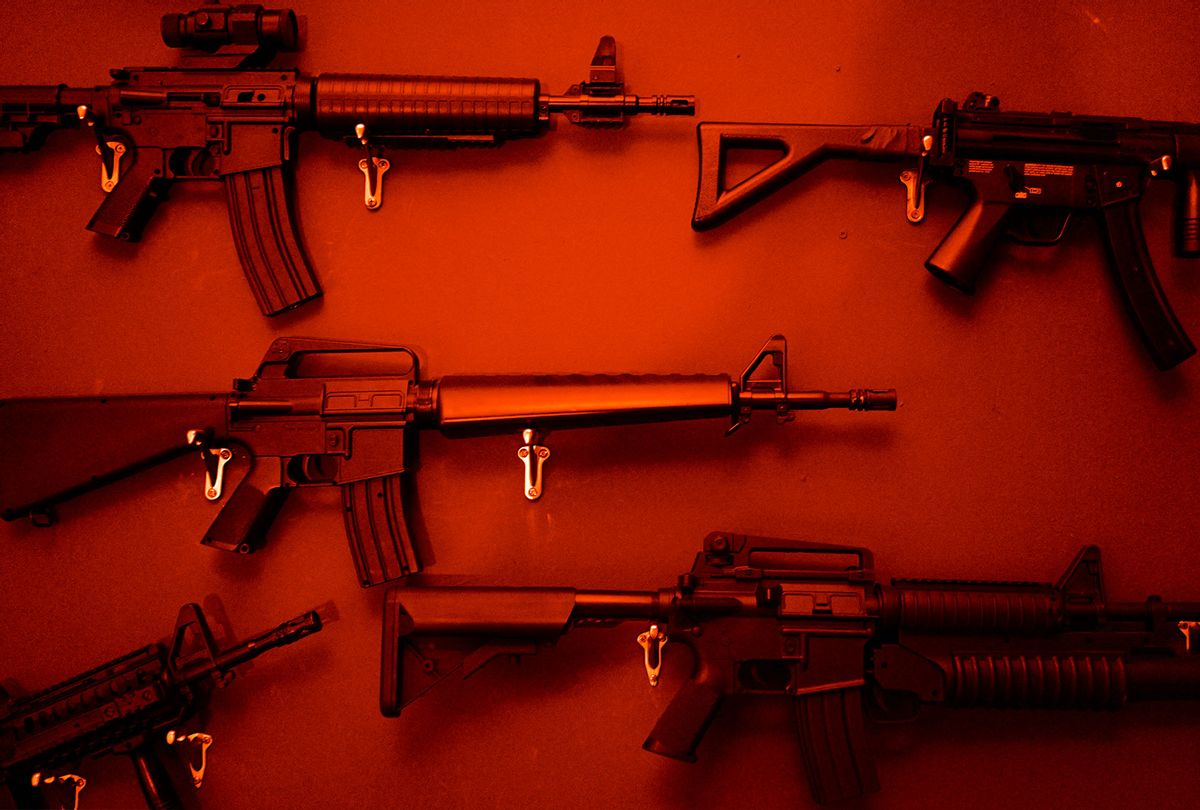 Numerous Assault Rifles Hanging On Wall (Getty Images)