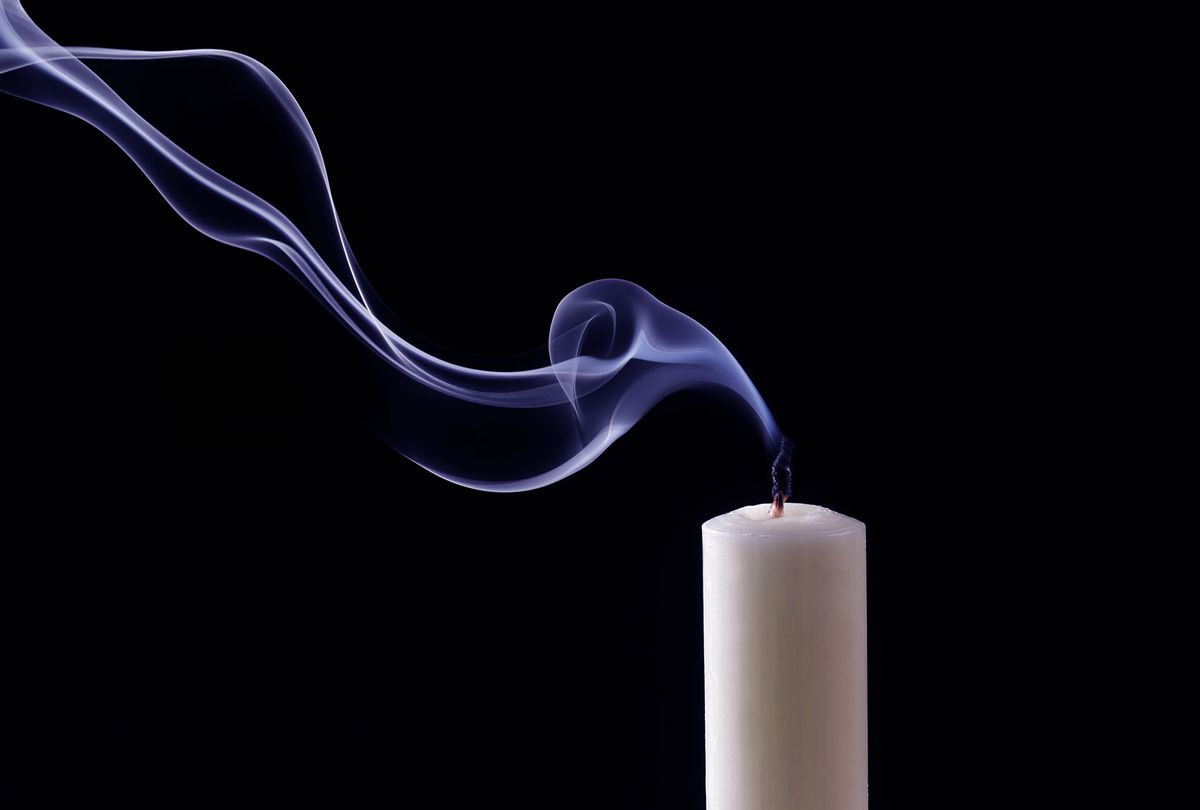 Smoke trailing from extinguished candle (Getty Images)
