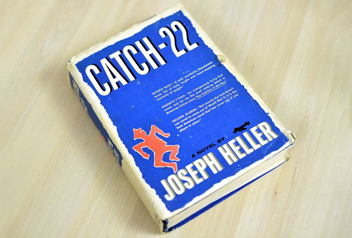 """An early edition of Joseph Heller's novel """"Catch-22"""" (NICHOLAS KAMM/AFP via Getty Images)"""