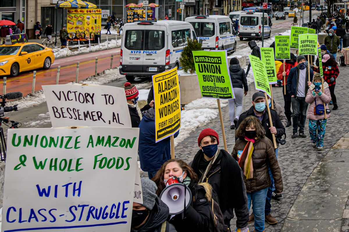 Protesters outside a Jeff Bezos-owned Whole Foods store in New York City, an event in solidarity with unionizing Amazon workers in Bessemer, Alabama. (Getty Images)