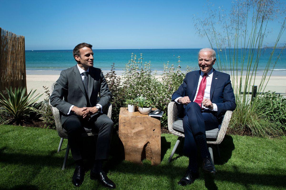 U.S. President Joe Biden and French President Emmanuel Macron speak at a G7 summit on June 12, 2021. (Getty Images)