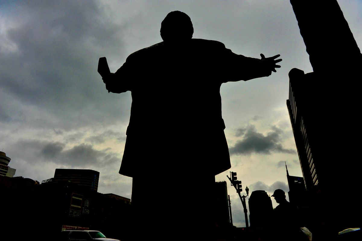 A 7-foot tall statue (with a 17-foot tall cross) of evangelist Billy Graham graces the front entrance to the headquarters of the Southern Baptist Convention in Nashville. (Getty Images)