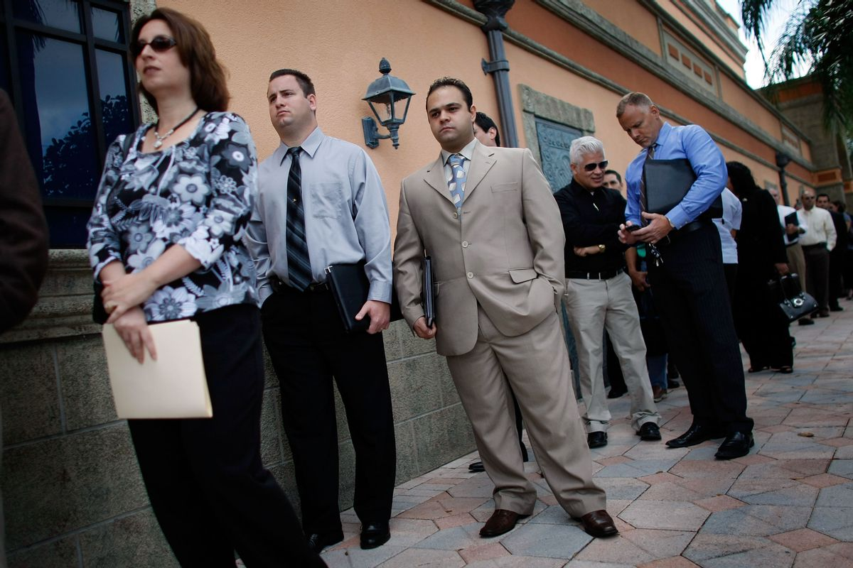 Dawn Dennan, left, Steven Oster, center, and Samer Eleid stand in line with hundreds of other job seekers as they look for jobs at the South Florida Diversity Job Expo in Davie, Florida. (Getty Images)
