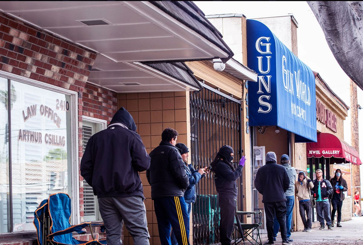 Shoppers wait in line to purchase ammunition and guns at Gun World in Burbank on Tuesday, March 17, 2020 as US sales of guns and ammunition soar amid the coronavirus outbreak. (Sarah Reingewirtz/MediaNews Group/Pasadena Star-News via Getty Images)