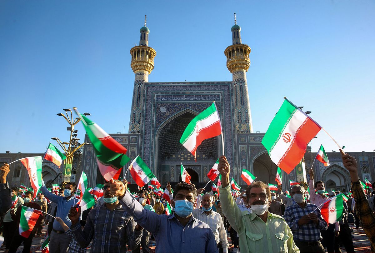 Supporters of Iran's President-elect Ebrahim Raisi cheer at the Imam Reza shrine in the city of Mashhad in northeastern Iran, on June 22, 2021. - On June 19 the 60-year-old was named the winner of the Islamic republic's presidential election, set to take over from moderate Hassan Rouhani in August. (MOHSEN ESMAEILZADEH/ISNA NEWS AGENCY/AFP via Getty Images)