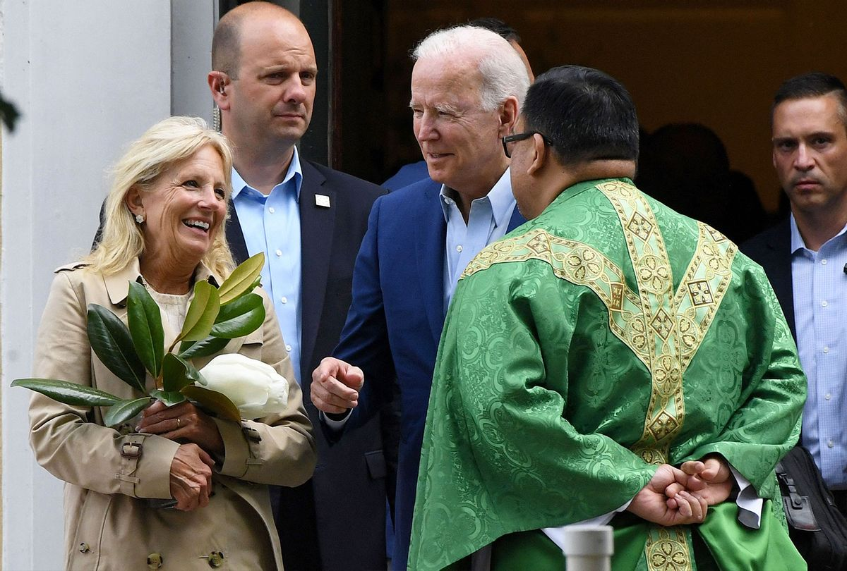 President Joe Biden and First Lady Jill Biden speak with a priest as they leave St. Joseph on the Brandywine Catholic Church in Wilmington, Delaware. (OLIVIER DOULIERY/AFP via Getty Images)