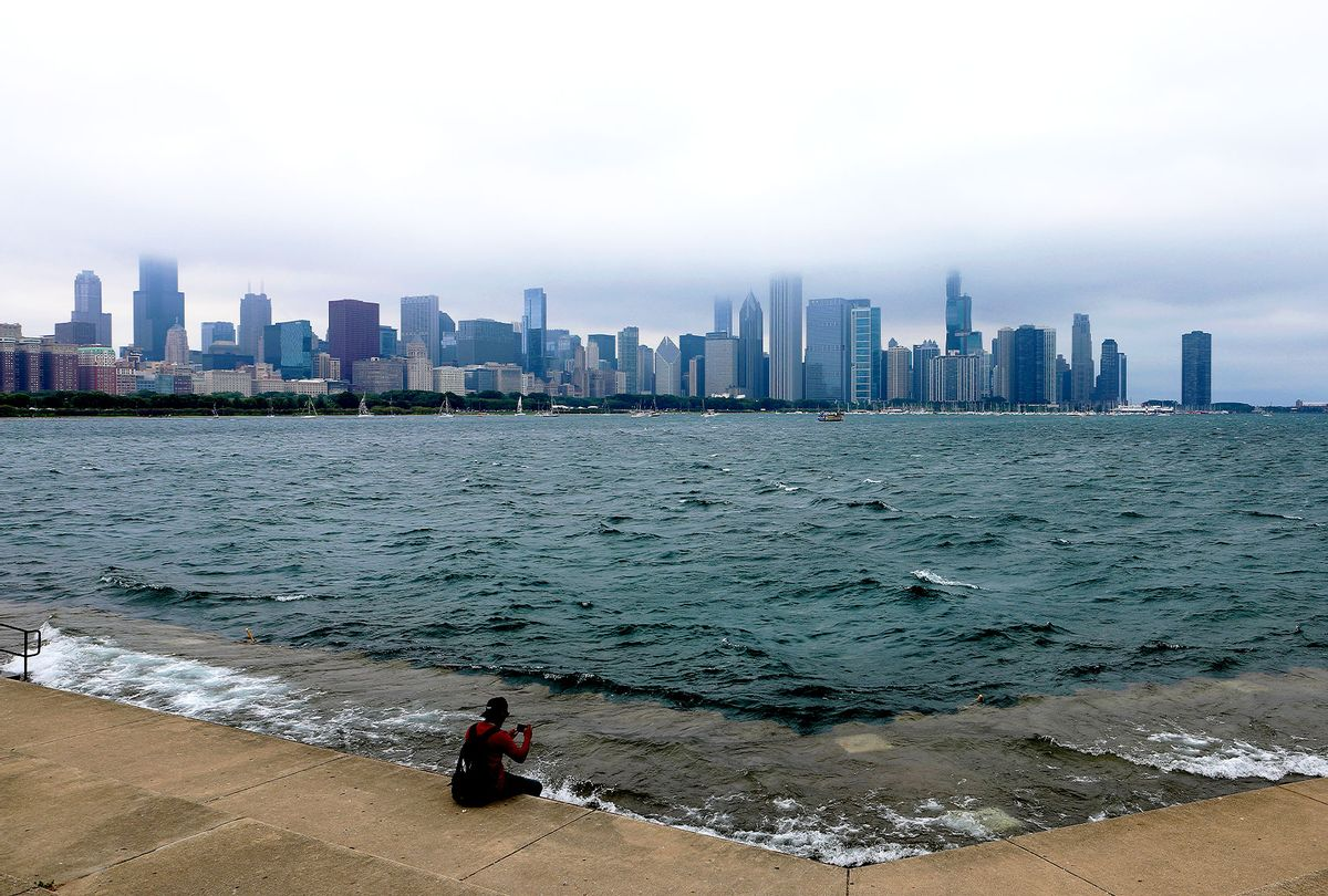 The waters of Lake Michigan crashes over the pedestrian walk as fog rolls through the Chicago skyline in Chicago, Illinois. (Raymond Boyd/Getty Images)
