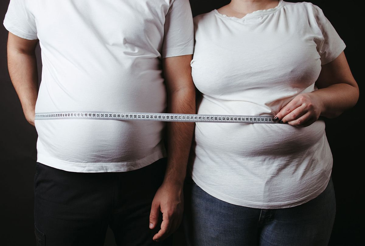 Overweight fat couple wrapped with measure tape (Getty Images/Vadym Petrochenko)