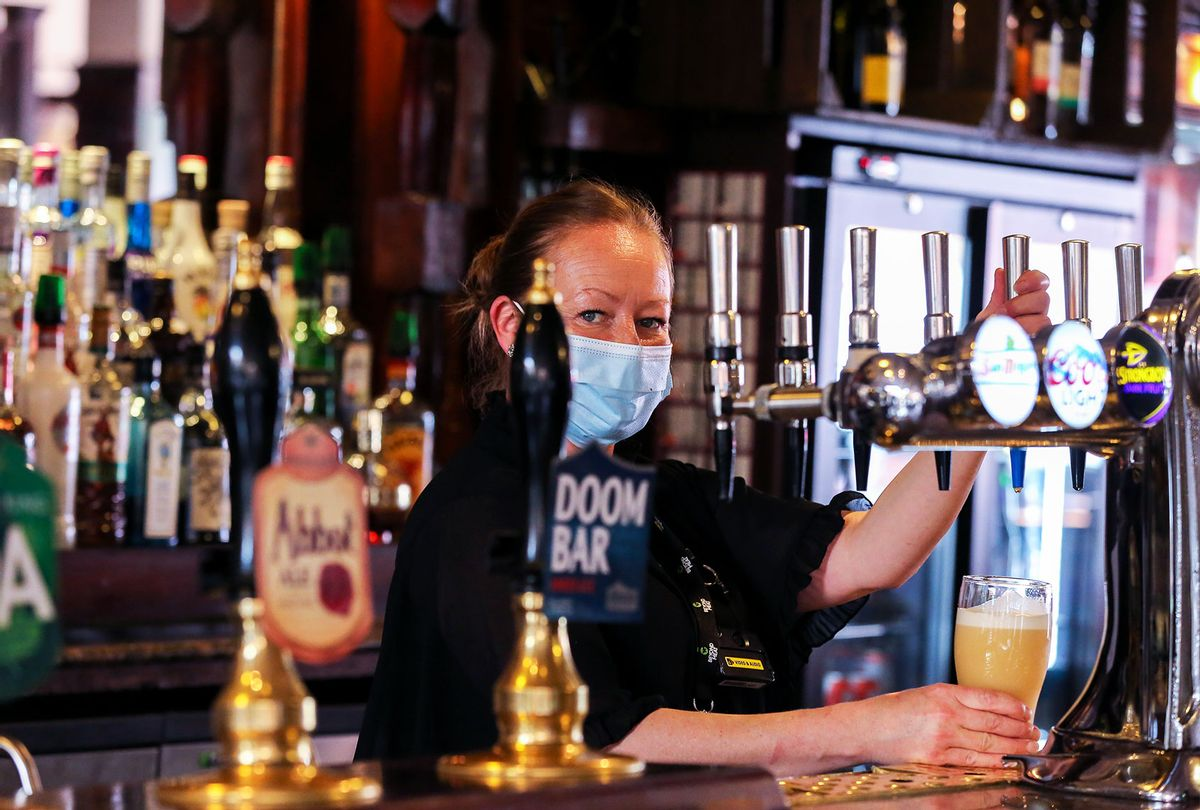 A barmaid prepares beer for a customer in a Pub (Dinendra Haria/SOPA Images/LightRocket via Getty Images)