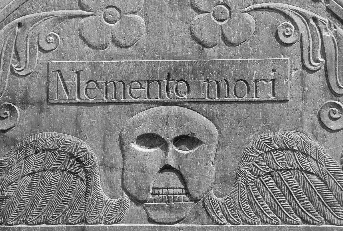 """18th century headstone in a cemetery in Concord, Massachusetts that reads """"Memento mori,"""" a Latin phrase meaning, """"Remember you will die"""" (iStock/Getty Images)"""