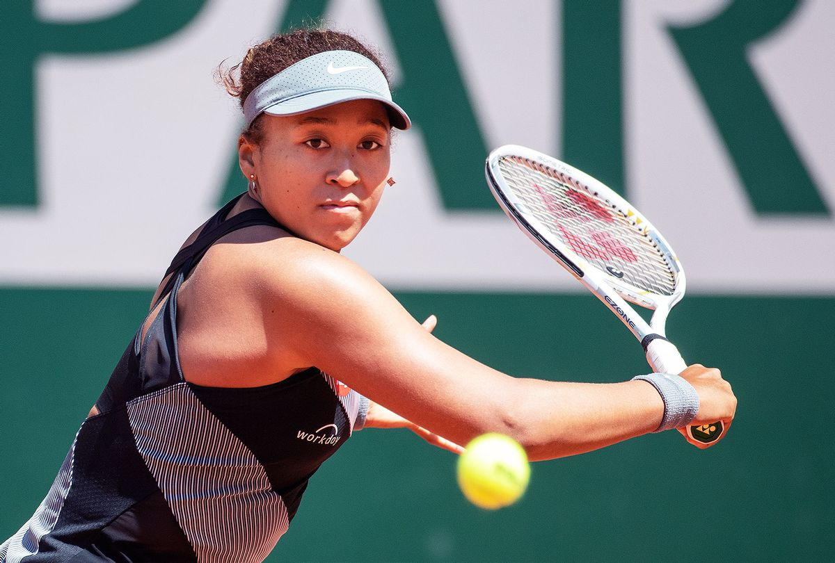 Naomi Osaka of Japan in action against Patricia Maria Tig of Romania in the first round of the Women's Singles competition on Court Philippe-Chatrier at the 2021 French Open Tennis Tournament at Roland Garros on May 30th 2021 in Paris, France. (Tim Clayton/Corbis via Getty Images)