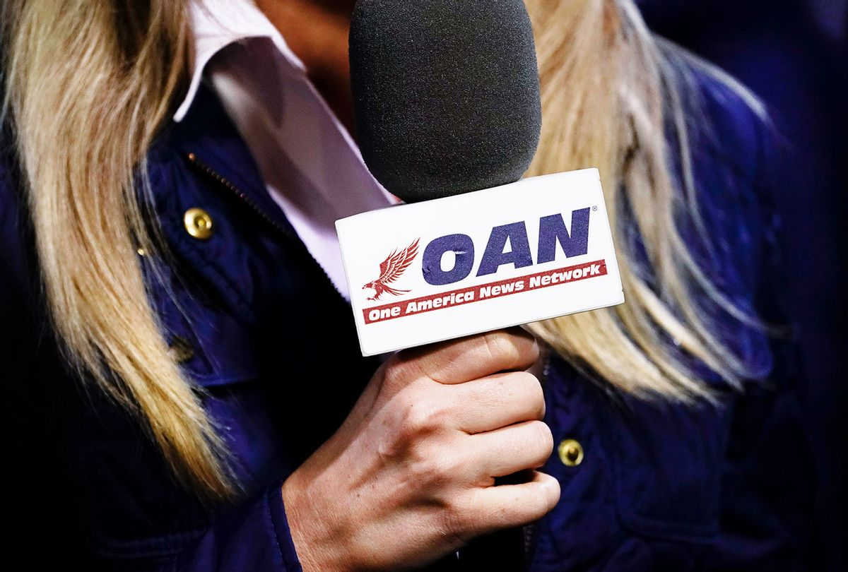 A reporter with One America News Network microphone (Drew Angerer/Getty Images)