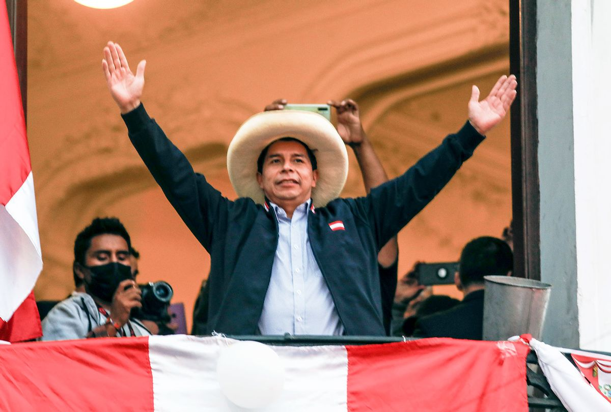 Presidential candidate Pedro Castillo of Peru Libre waves supporters at his political party's headquarters balcony after a tight runoff against presidential candidate for Fuerza Popular Keiko Fujimori on June 7, 2021 in Lima, Peru. (Ricardo Moreira/Getty Images)