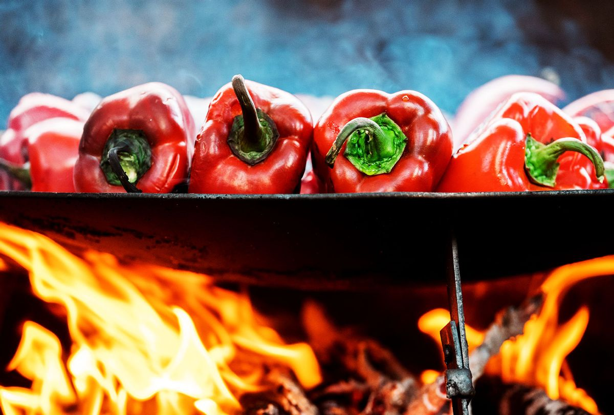 Red bell peppers on barbecue tray (Getty Images)