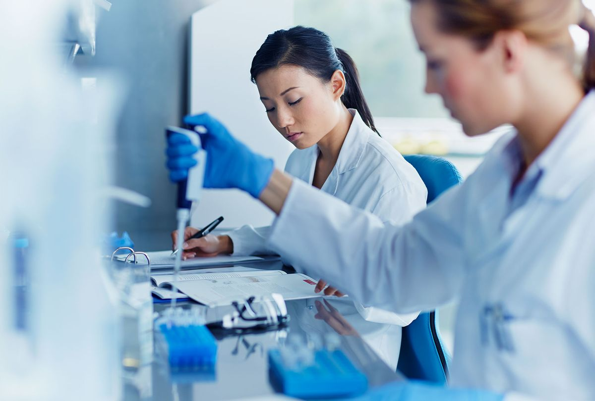 Scientists working in modern biotechnology laboratory (Getty Images)