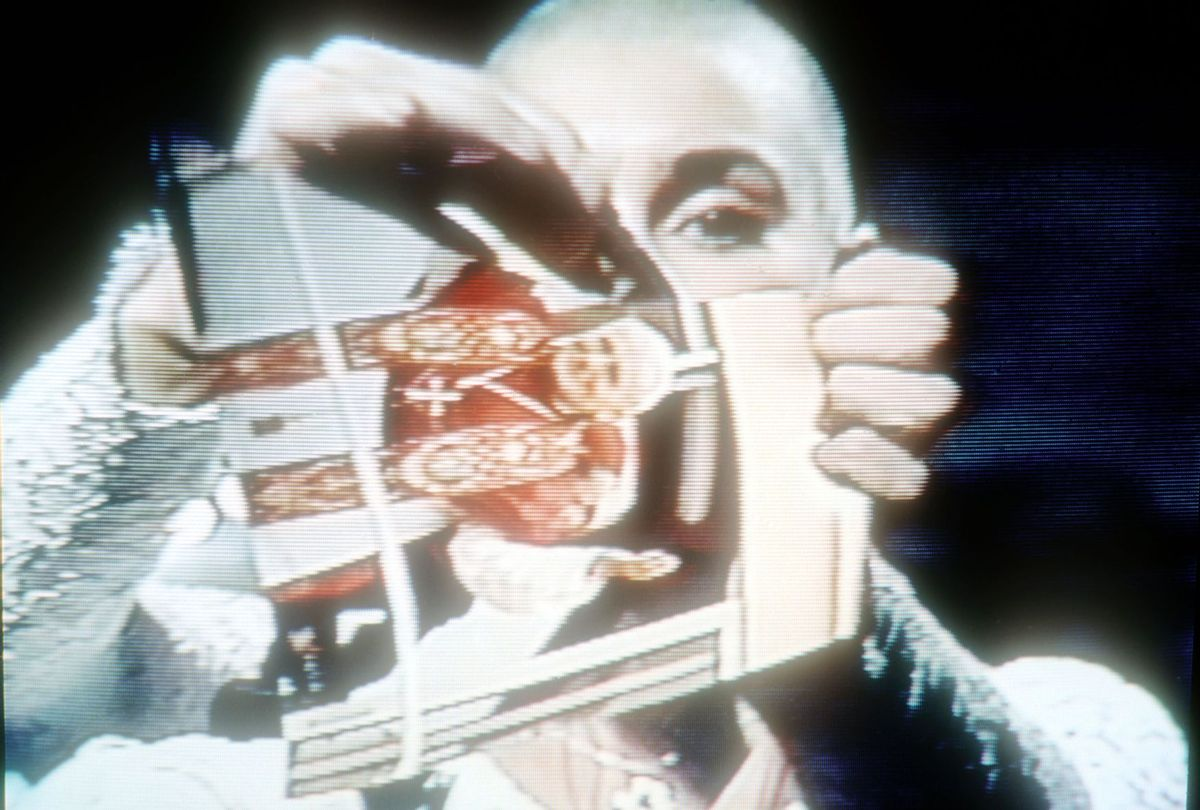 """Sinead O'Connor rips photo of the Pope on """"Saturday Night Live"""" October 3, 1992 (Yvonne Hemsey/Getty Images)"""