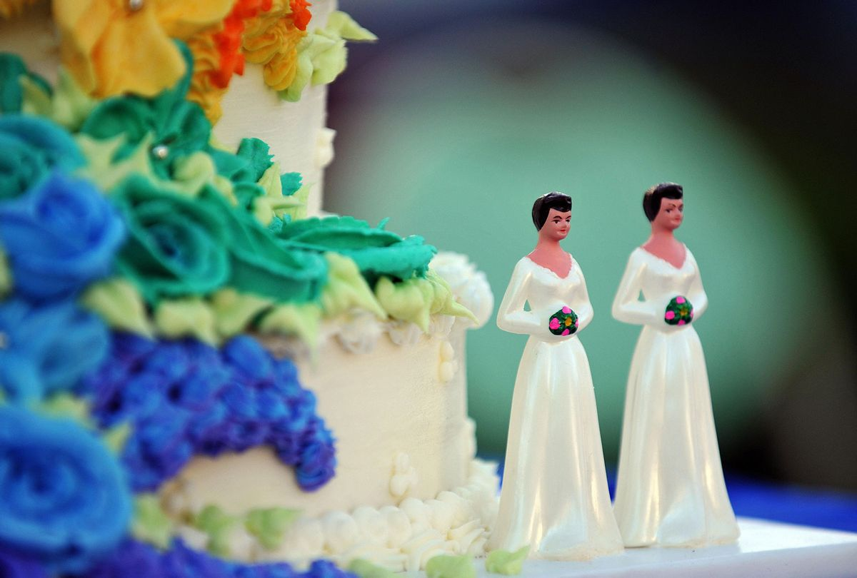 Wedding cake decorated with figures of two brides (GABRIEL BOUYS/AFP via Getty Images)